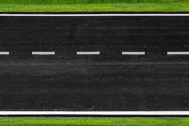 Asphalt road with marking lines white stripes texture background Premium Photo