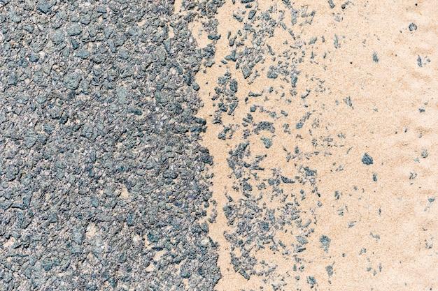 Asphalt road with sand Free Photo