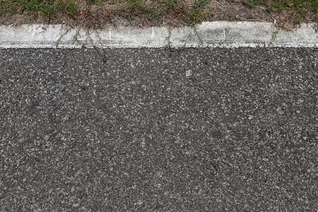 Asphalt road with stripes and green grass texture background,empty copy space. Premium Photo