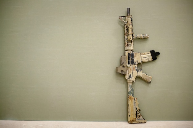 Assault rifle, painted in sand color. Premium Photo
