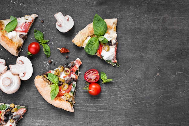 Assorment with pizza slices and mushrooms Free Photo