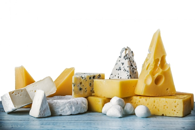 Assorted cheeses, soft, hard, rennet and brine Premium Photo