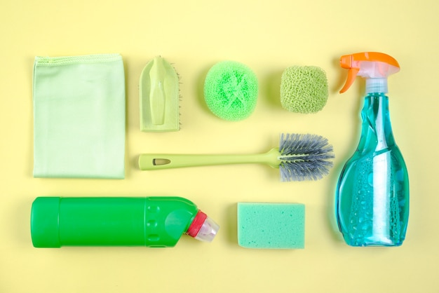 Assorted cleaning products on yellow background Free Photo