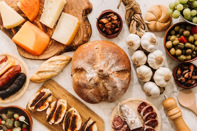 Assorted food around bread Free Photo