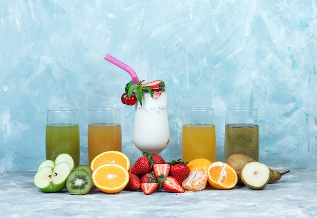 Assorted juices with milkshake and fruits Free Photo