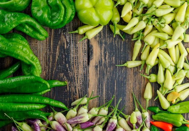 Assorted peppers on a wooden. flat lay. Free Photo
