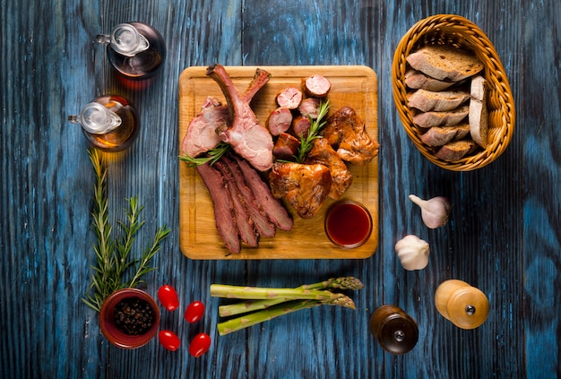 Assorted smoked meat on rustic wooden background Premium Photo