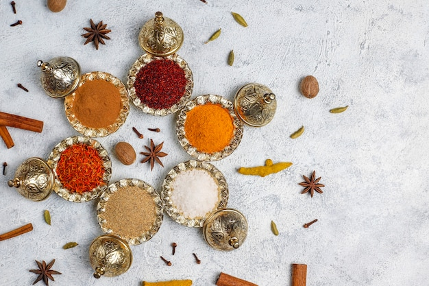 Assorted spices on kitchen table Free Photo