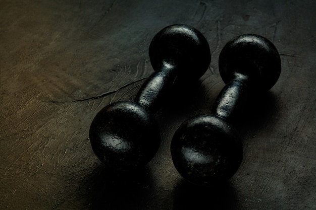 Assorted sports equipment isolated on black studio background Free Photo
