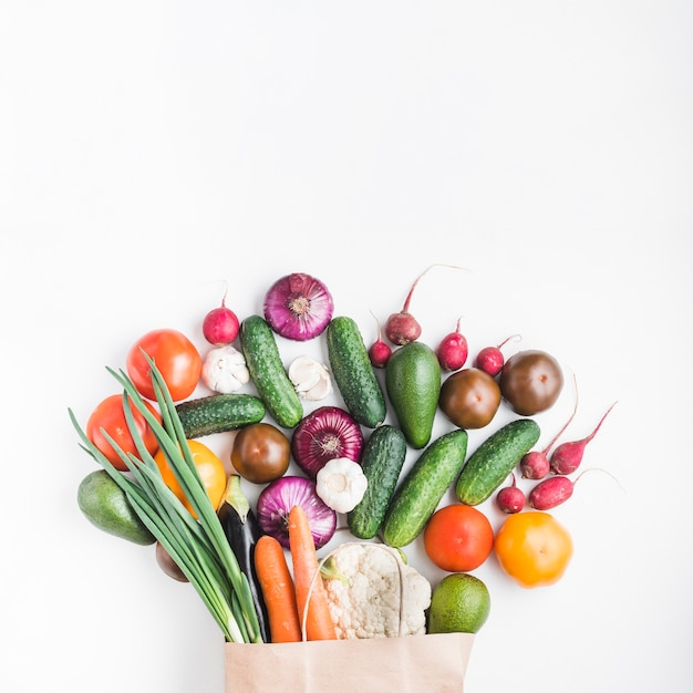 Assorted vegetables near paper bag Premium Photo