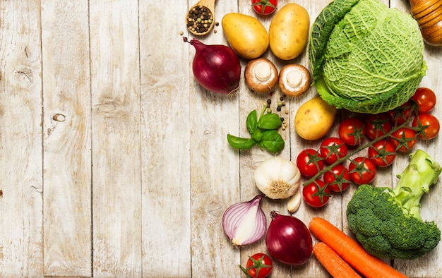 Assorted vegetables on a wooden table photo premium download
