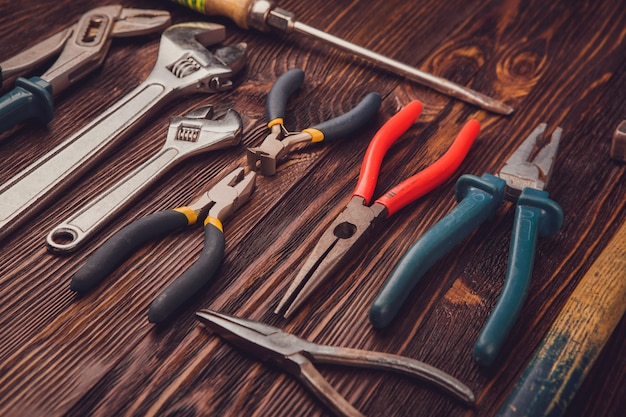 Assorted work tools on wood Premium Photo