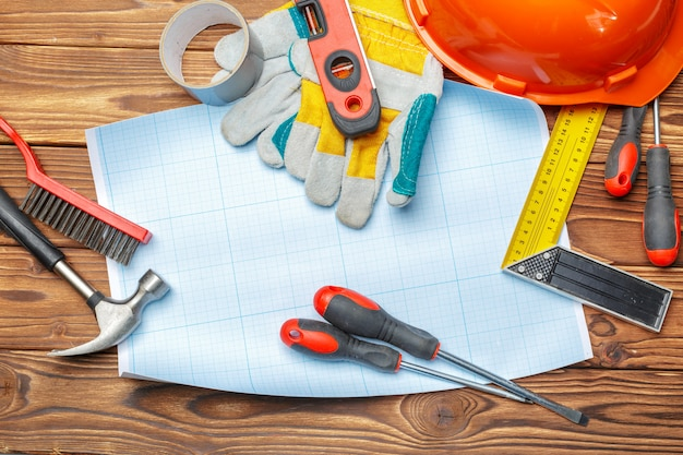 Assorted work tools on wooden table Premium Photo