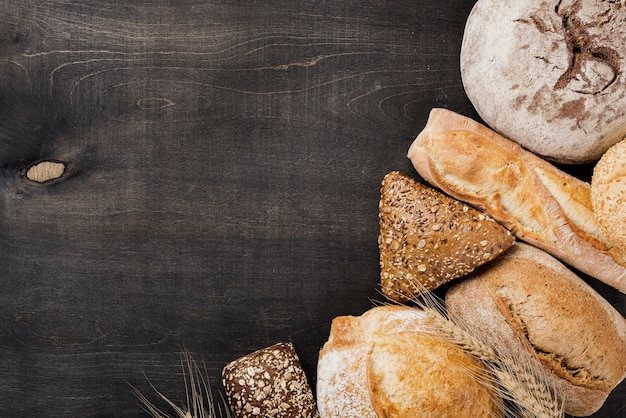 Assortment of baked bread on wooden background Free Photo