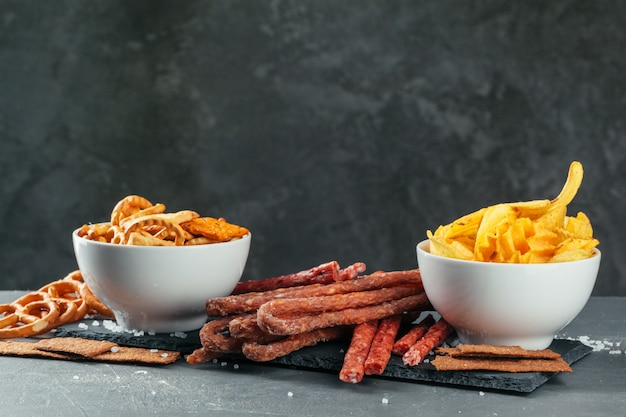 Assortment of beer snacks close up on counter Premium Photo