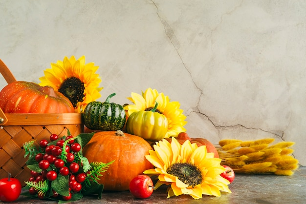 Assortment of berries with pumpkins and flowers Free Photo