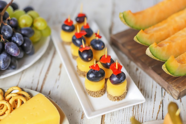 Assortment of canapes on white table. Free Photo