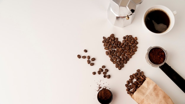 Assortment of coffee beans on white surface Free Photo