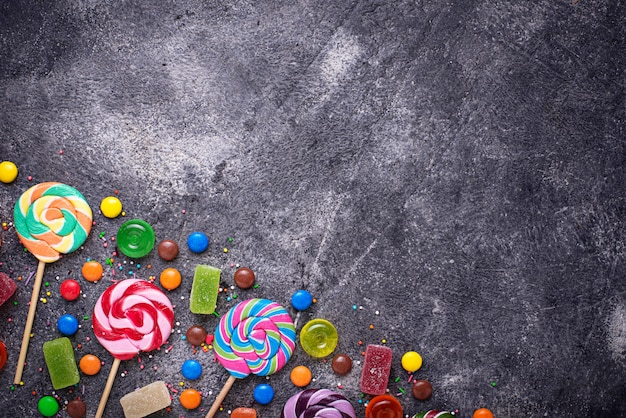 Assortment of colorful candies and lollipops Premium Photo