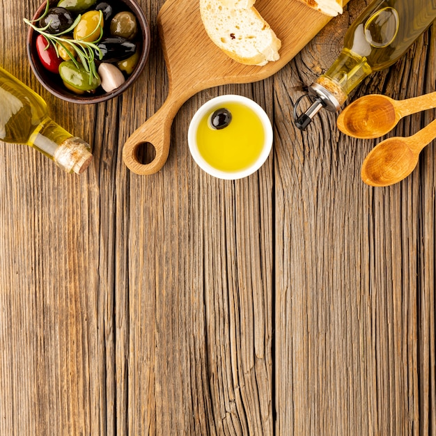 Assortment of colorful olives with oil saucer bread and copy space Free Photo