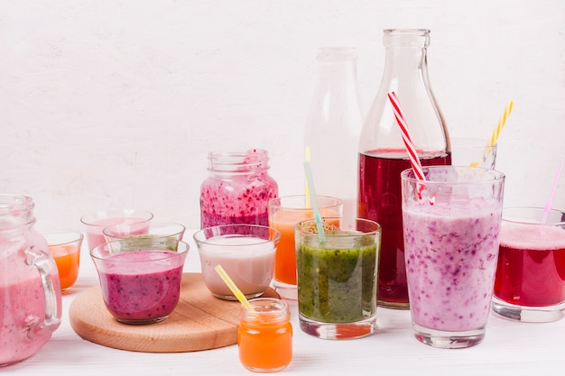 Assortment of colorful smoothies on table Free Photo