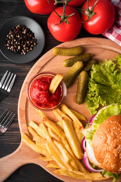 Assortment of delicious hamburger and fries Free Photo