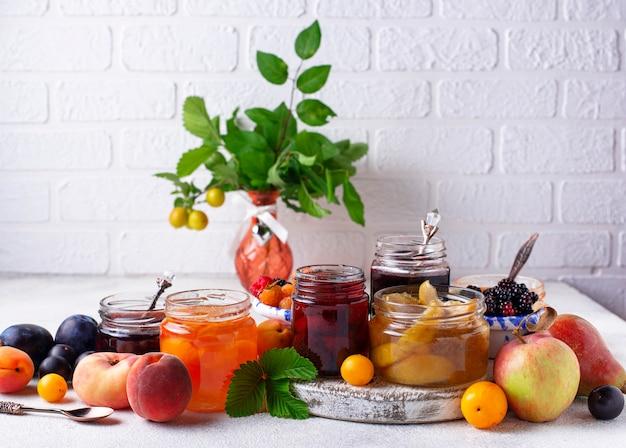 Assortment of different jams in gars Premium Photo