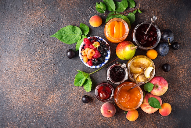 Assortment of different jams in jars Premium Photo