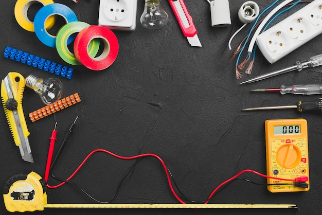 Assortment of electrical tools on table Free Photo