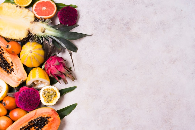Assortment of fresh exotic fruits with copy space Free Photo