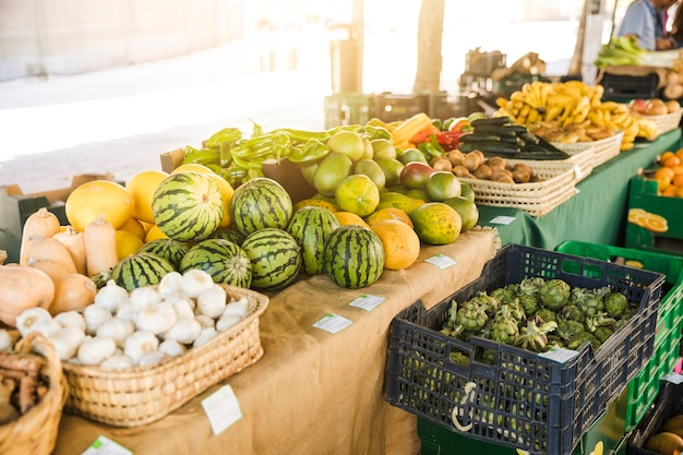 Assortment of fresh fruits and vegetables at grocery store market Free Photo