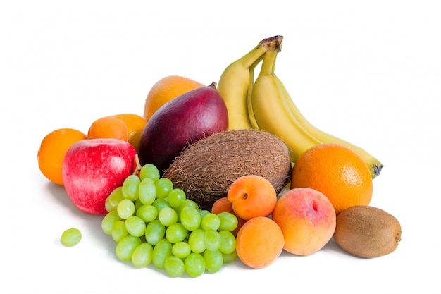 Assortment of fruit bananas, mango, green grapes, apple, coconut, peaches, apricots, tangerines and kiwi are isolated. Premium Photo