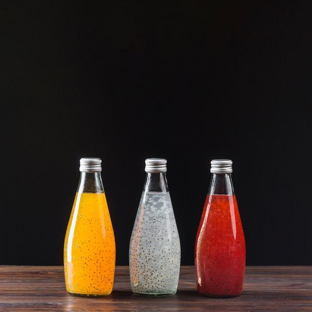 Assortment of fruit juices on black background Free Photo
