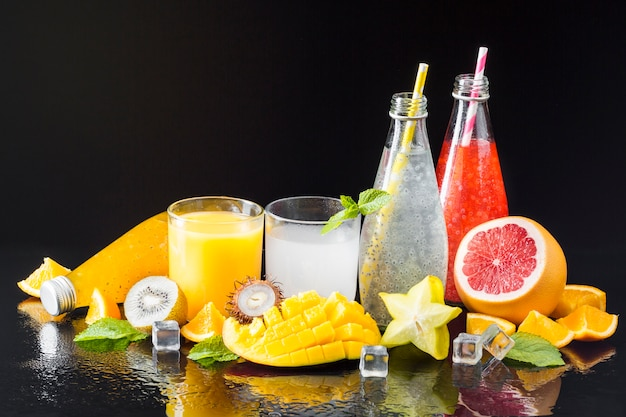 Assortment of fruit and juices Free Photo