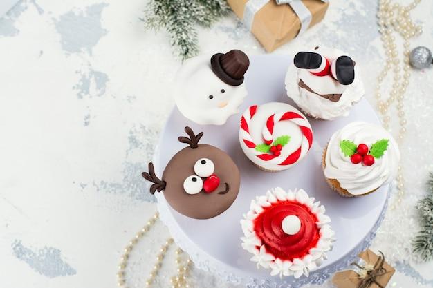 Assortment of funny christmas cupcakes Premium Photo