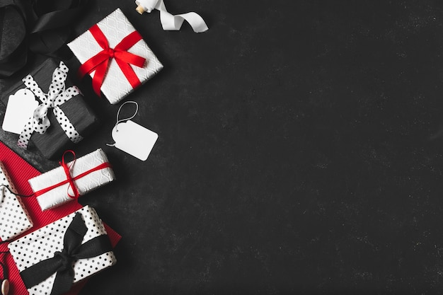 Assortment of gifts with tags and copy space Free Photo