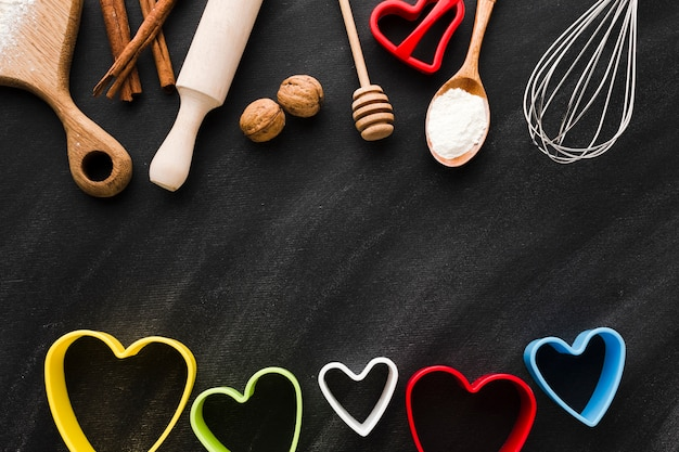 Assortment of kitchen utensils with colorful heart shapes Free Photo