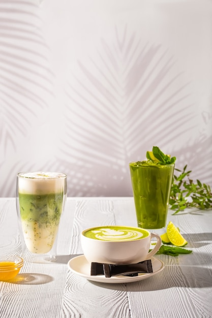 Assortment of matcha green tea beverages - ice green tea, frappe and hot milk green tea Premium Photo