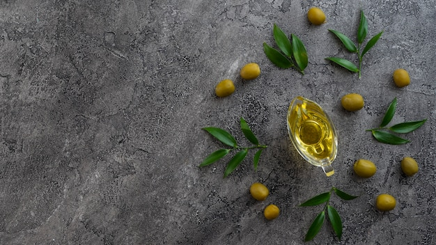 Assortment of oils on marble background Free Photo