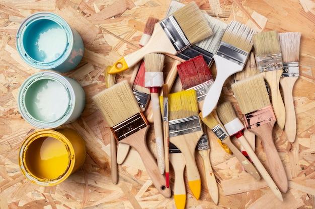 Assortment of paint brushes and acrylic Free Photo