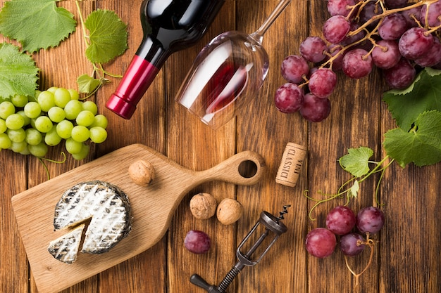 Assortment of red wine and food Free Photo