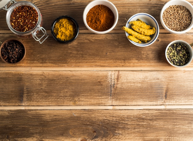 Assortment of spices in bowls and jar Free Photo