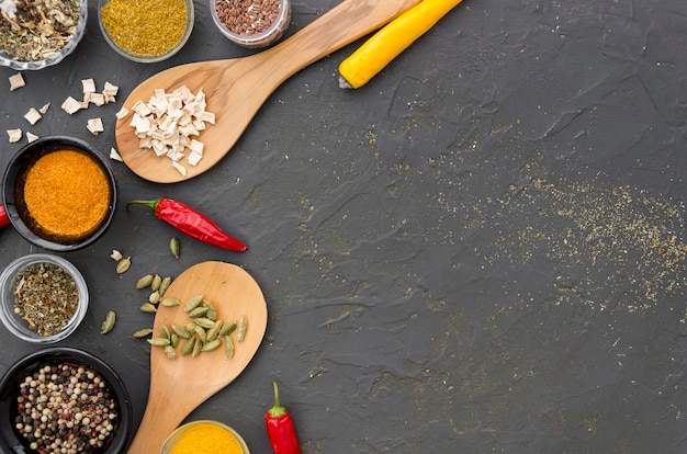 Assortment of spices and herbs on a grey copy space background Free Photo