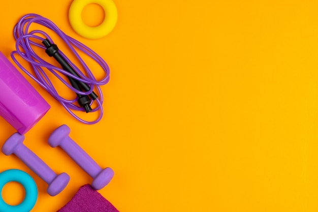 Assortment of sport equipment on yellow Premium Photo