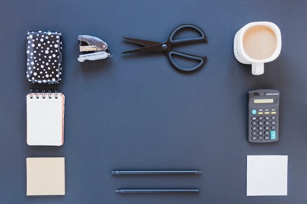 Assortment of stationery near coffee cup and calculator Free Photo