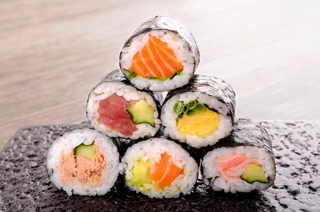 Assortment of sushi rolls Free Photo
