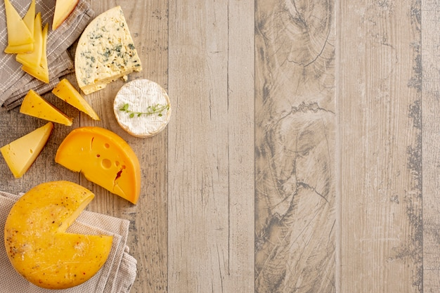 Assortment of tasty cheese with copy space Free Photo