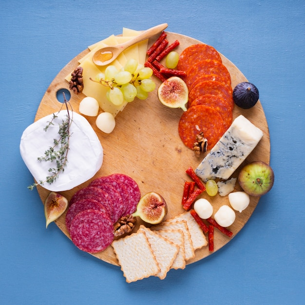 Assortment of tasty snacks on a table Free Photo