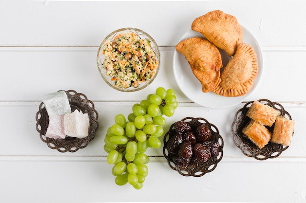 Assortment of traditional turkish sweet dishes Free Photo