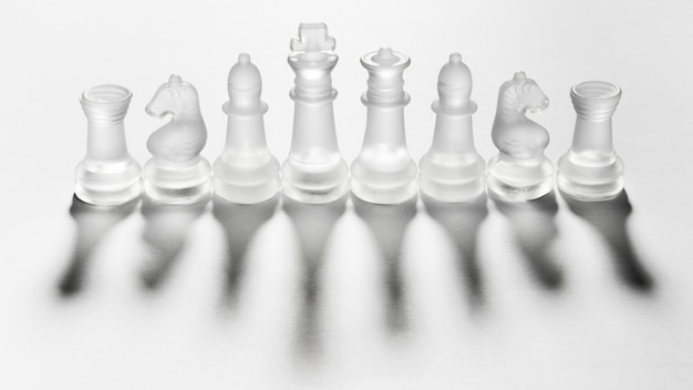 Assortment of transparent chess pieces Free Photo